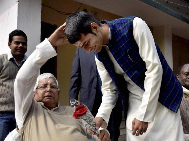 RJD chief Lalu Prasad giving blessings to his son and Bihar health minister Tej Pratap in Patna.