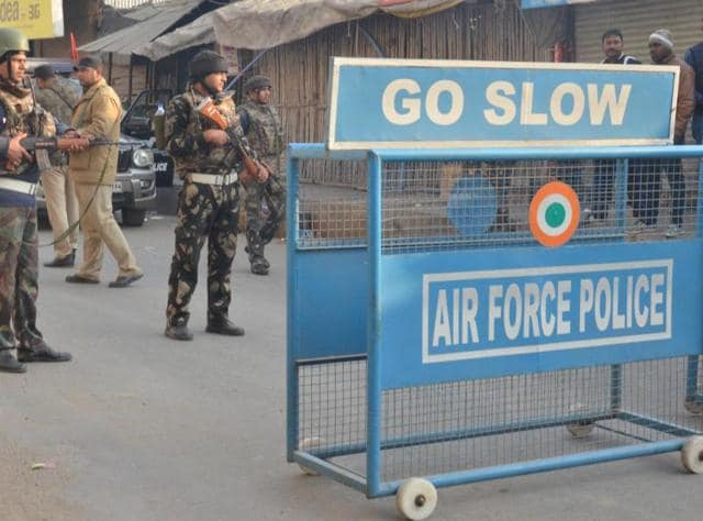 An Indian Air Force soldier takes up position outside Air force base on the perimeter of an airforce base in Pathankot on January 3, 2016.