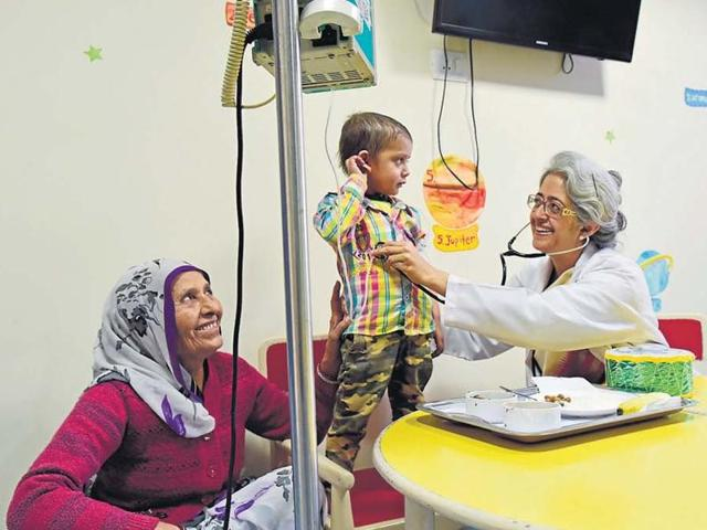 Dr Gauri Kapoor of the Rajiv Gandhi Cancer Hospital checks Krishna, a cancer patient. Dr Kapoor has come up with a nutrition guide for children with cancer.
