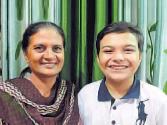 Jeevesh Joon, who has achieved the rare feat of clearing the Biology Olympiad, with his mother.