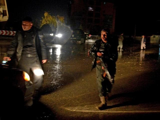 Afghan security forces surround a house which is used by a group of gunmen to attack on the Indian Consulate in Mazar-e-Sharif, Afghanistan. An explosion was reported on Tuesday near the Indian consulate in the eastern city of Jalalabad.