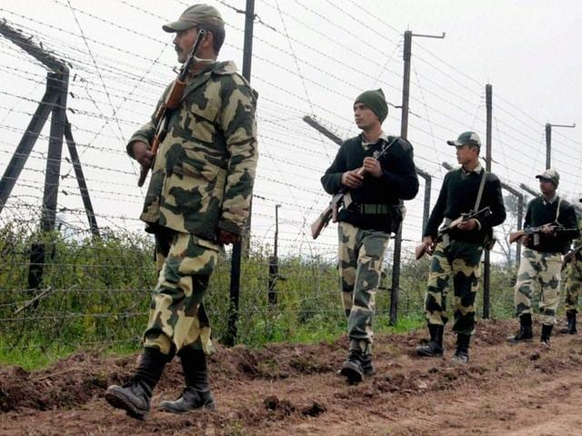 Border Security Force (BSF) soldiers patrol the border fence at Bamial border in Pathankot on Monday. The security has been beefed up in the wake of the recent attacks.