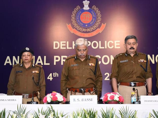 Police officers pay respect to the securitymen killed in the Pathankot terrorist attack before their annual press conference.