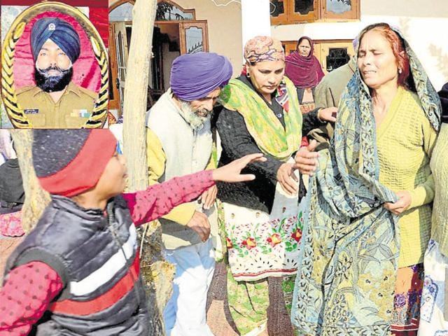 Kulwant Singh's family members mourning at his house at Chak Sharif village near Gurdaspur.