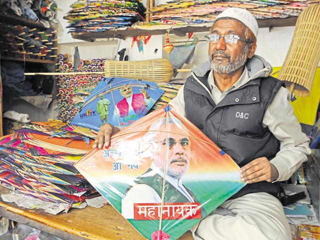 Talib shows a kite with Prime Minister Narendra Modi's picture on it at his shop in Ranchi.
