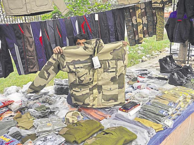 Roadside vendors in Ghaziabad sell a battle-fatigue jacket for around Rs. 900 and an army sweater for Rs. 400.