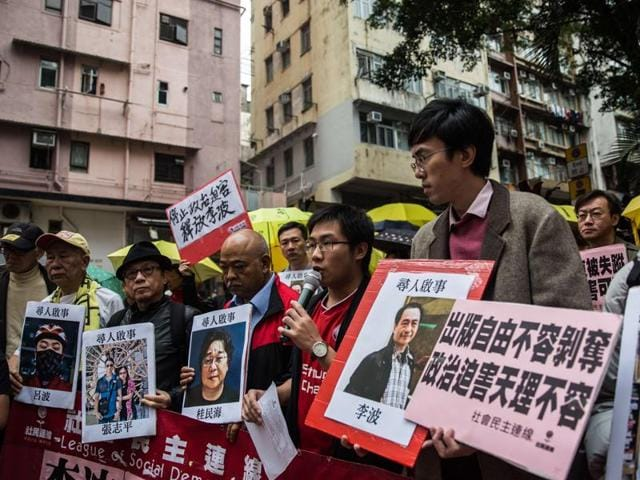 Protestors hold 'missing person' posters of publishers. Hong Kong police said late Monday that one of the five missing Hong Kong booksellers, Lee Bo's wife cancelled the report, but that they would continue investigating the other cases.