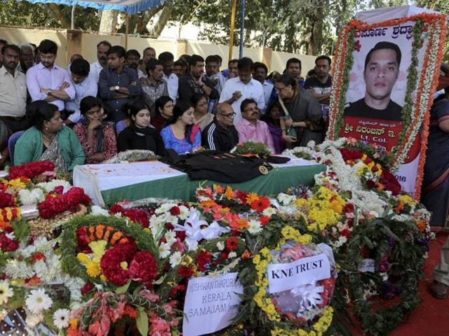 Relatives, friends and others pay their last respects to NSG commando Niranjan Kumar in Bangalore on Monday. Lt Col Kumar was among those killed in the attack on the Pathankot air force base near the Pakistan border.
