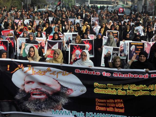 Shia Muslims take part in a rally to condemn the execution of Saudi Shia cleric Sheikh Nimr al-Nimr, in Lahore, Pakistan.