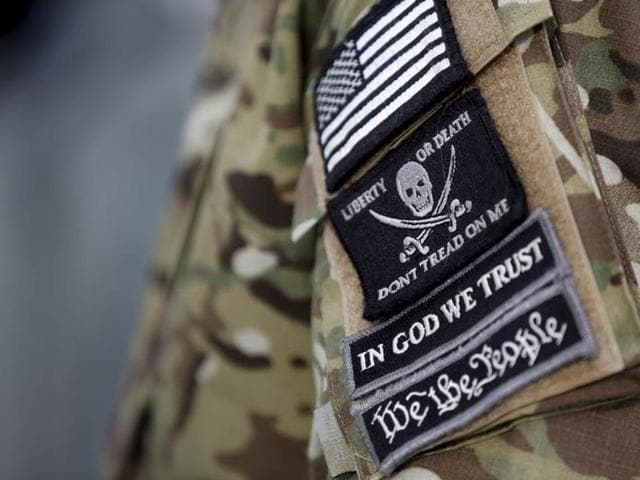 Patches on the sleeve of a militiaman is seen at the Malheur National Wildlife Refuge near Burns, Oregon, January 4, 2016.