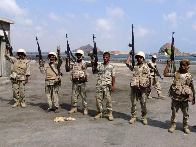 Army soldiers hold up their weapons after taking over the main port of Yemen's southern city of Aden from gun men. The United Nations has expressed fears that peace efforts in Yemen and Syria will be jeopordised by the recent fallout between Saudi Arabia and Iran.