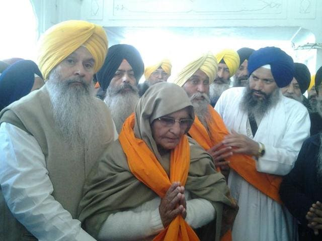 Relative of Satwant Singh being presented 'siropa' at Golden Temple, Amritsar.