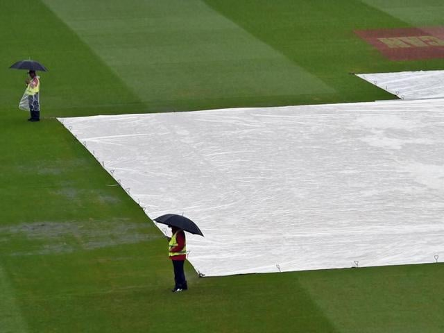 Security personnel stand guard as rain delays play on the fourth day of the third cricket Test match between Australia and the West Indies in Sydney.