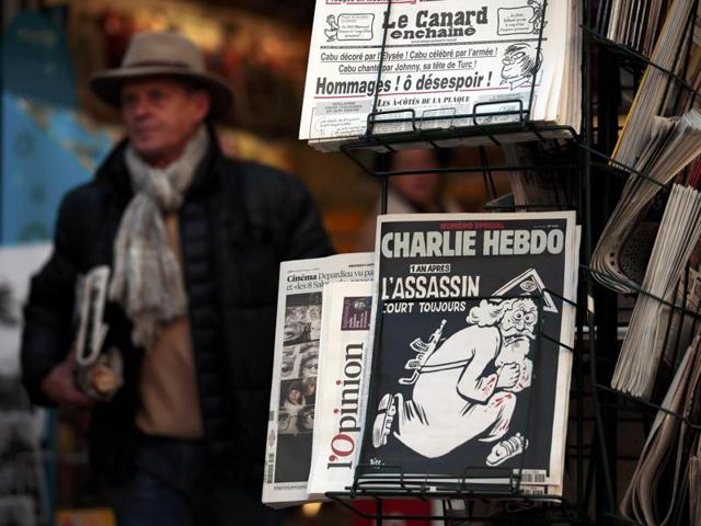 A copy of the latest edition of French weekly newspaper Charlie Hebdo with the title