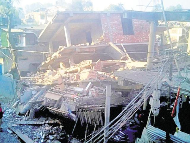 Debris of building a day after it collapsed in a massive earthquake in Imphal on Tuesday.