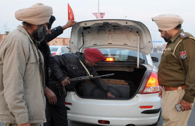 Security personnel checking a vehicle near the international airport in SAS Nagar on Tuesday..