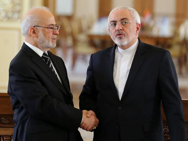 Iraqi foreign minister Ibrahim al-Jaafari (L) shakes hands with his Iranian counterpart Mohammad Javad Zarif after a press conference in Tehran on Wednesday. Jaafari held talks in Tehran with a focus on the crisis between Saudi Arabia and Iran as international concern mounts.