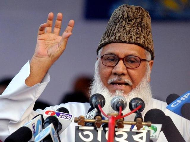 Bangladesh's attorney general Mahbubey Alam (C) walks out of the Supreme Court after a review petition of Jamaat-e-Islami party's senior leader Motiur Rahman Nizami's appeal against his death sentence was dismissed, in Dhaka.