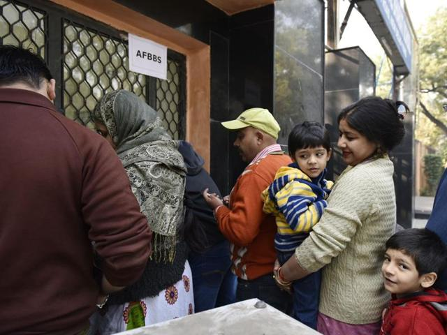 Parents buy nursery admission forms for their children at Air Force Bal Bharti School at Lodhi Road in New Delhi on Friday.