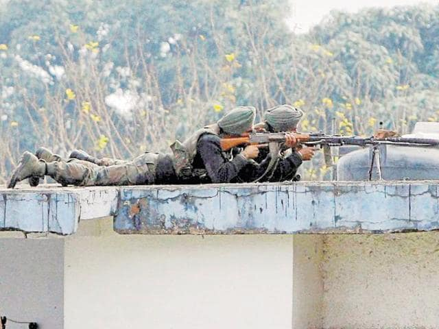 Soldiers on the top of a building at the Indian air force base in Pathankot on Wednesday, a day after the end of military operations against militants.