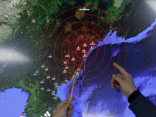 Officers from the Korea Meteorological Administration point at the epicenter of seismic waves in North Korea, at the National Earthquake and Volcano Center of the Korea Meteorological Administration in Seoul, South Korea, Wednesday.