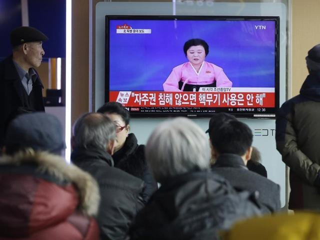 This picture taken from North Korean TV and released by South Korean news agency Yonhap on January 6, 2016 shows North Korean leader Kim Jong-Un signing a document of a hydrogen bomb test in Pyongyang. North Korea announced on January 6 it had successfully carried out its first hydrogen bomb test, a development that, if confirmed, would marking a stunning step forward in its nuclear development.