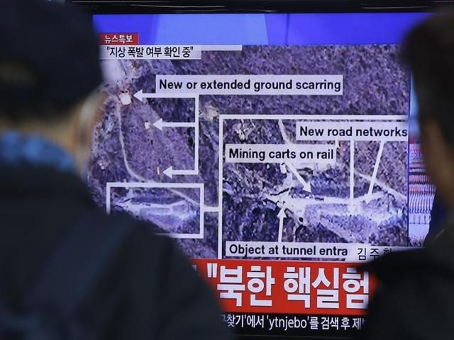 People watch a TV screen showing the news reporting about an earthquake near North Korea's nuclear facility at the Seoul Railway Station in Seoul, South Korea, Wednesday.