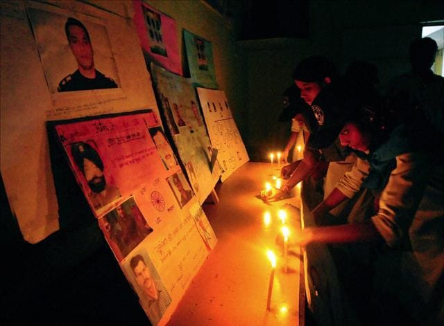 School students pay tribute to Pathankot martyrs in Ahmedabad on Tuesday.