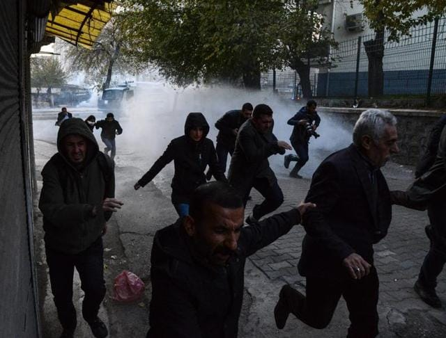 Turkish police use water-canon and tear gas to disperse demonstrators in the Sur district which is under curfew for several days in Diyarbakir in December.  Three female Kurdish campaigners have been killed in fighting in a curfew-hit town in southeast Turkey  on Wednesday.