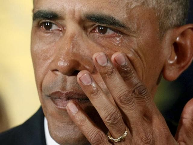 US President Barack Obama weeps at the White House on Tuesday while delivering a statement on actions to reduce gun violence.