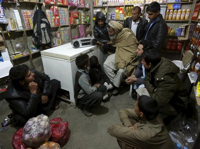 Afghans listen to a radio broadcast run by the Islamic State militants in the eastern city of Jalalabad. The Afghan government has formed a special force to counter the dreaded terror group in the country.