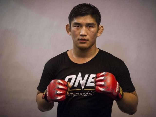 This photo taken on January 6, 2016 shows mixed martial arts fighter Aung La N Sang posing for photos during a training session at a gym in Yangon.