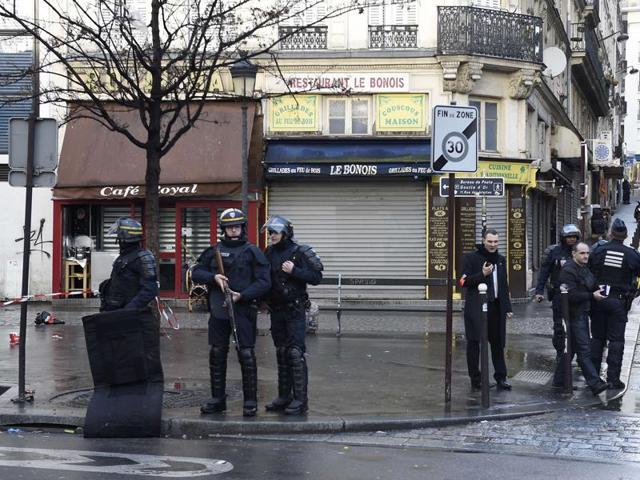 Armed French police patrol near the Boulevard de Barbes in the north of Paris, after authorities shot a man dead as he was trying to enter a police station in the nearby Rue de la Goutte d'Or.