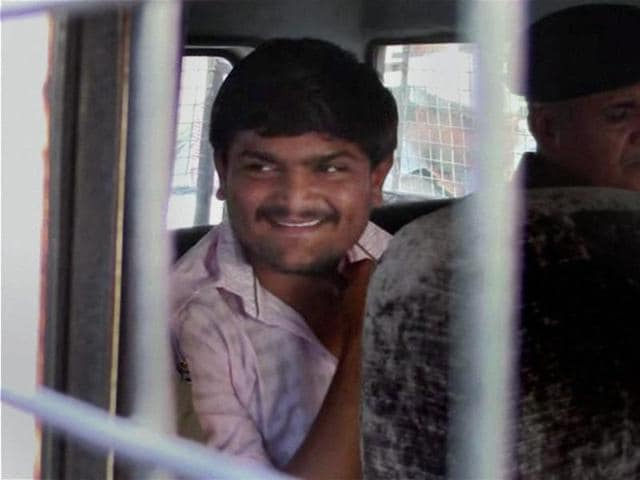Convener of Patidar Anamat Andolan Samiti Hardik Patel being taken to a court in Surat on Monday.