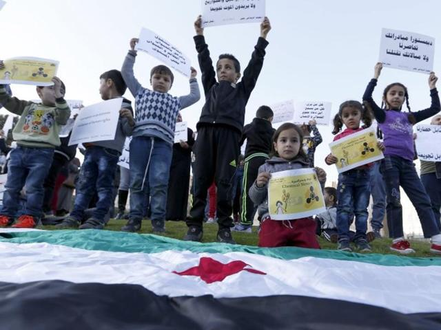 Syrian children carry placards as they call for the lifting of the siege off Madaya and Zabadani towns in Syria, in front of the offices of the UN headquarters in Beirut, Lebanon.