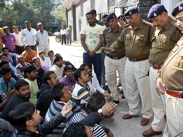 The family members of Saurabh Suryavanshi and residents of Bhagirathpura at DIG office in Indore on Wednesday.