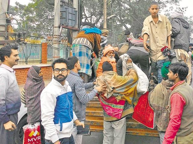 Ludhiana MC workers shifting beggars to a night shelter in Ludhiana on Thursday.