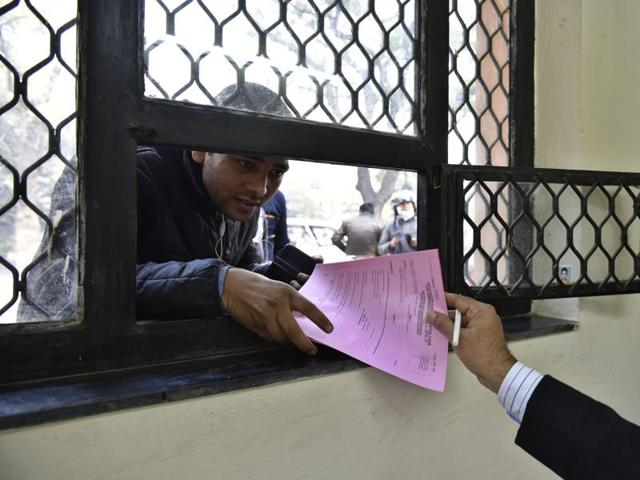 Parents buy admission forms for nursery for their chiildren at Air Force Bal Bharti School at Lodhi Road in New Delhi.