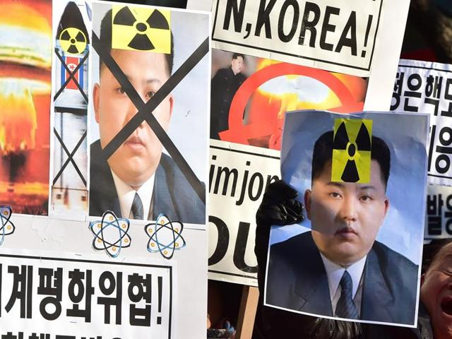 South Korean activists shout slogans with placards showing portraits of North Korean leader Kim Jong-Un during a rally denouncing North Korea's hydrogen bomb test in Seoul.