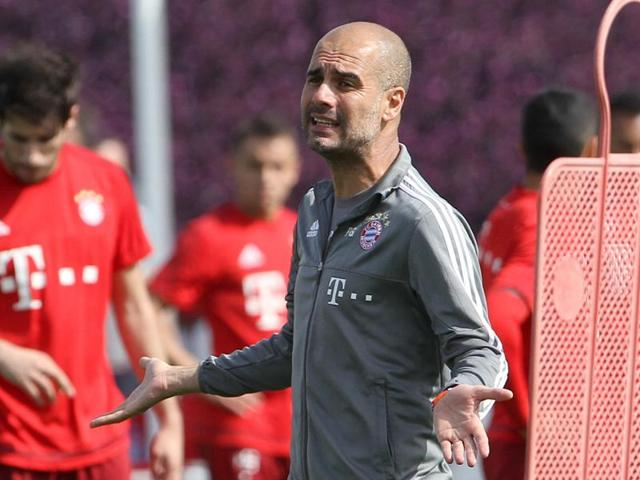 Head coach of German First division football club Bayern Munich Pep Guardiola attends a training session in Munich.