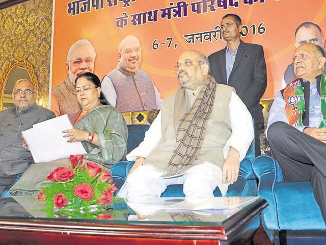 BJP national president Amit Shah flanked by CM Vasundhara Raje and party state president Ashok Parnami in Jaipur on Wednesday.