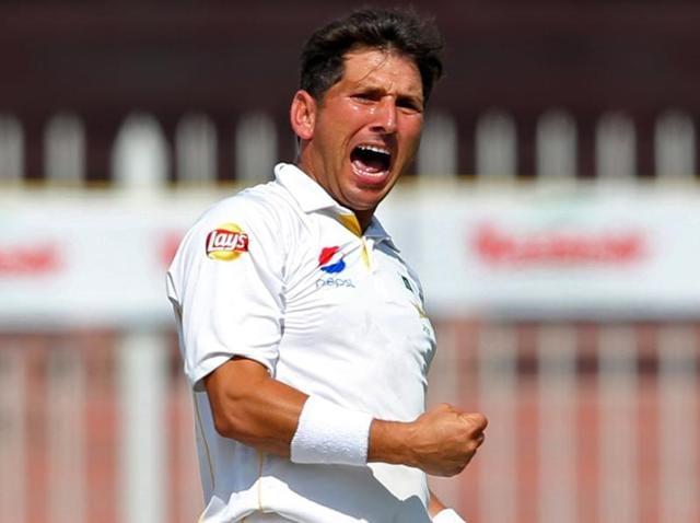 Pakistan's Yasir Shah celebrates the wicket of England's Stuart Broad.