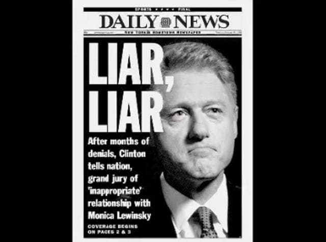 "A shot shows a New York tabloid featuring Bill Clinton's face and the headline ""Liar, Liar,"" after the then-president admitted he had carried out an ""inappropriate"" relationship."