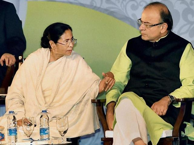 West Bengal Chief Minister Mamata Banerjee felicitates Finance Minister Arun Jaitley while Delhi Chief Minister Arvind Kejriwal and Bhutan Prime Minister Tshering Tobgay look on during Bengal Global Business Summit in Kolkata on Friday.