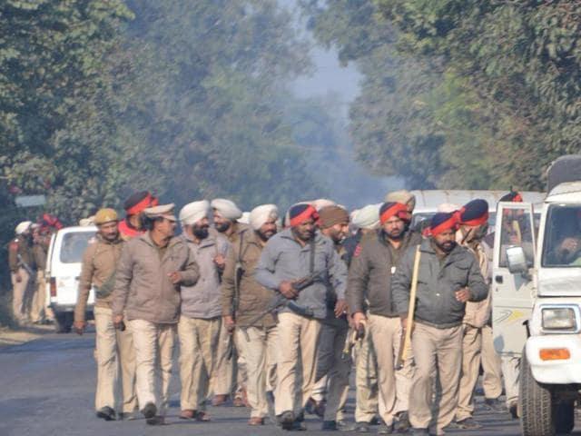 Punjab Police Jawan in position during search operation at village Pandher on Friday.