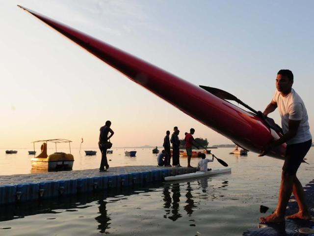 A player coming out of the Upper Lake along with his boat in Bhopal on Friday.