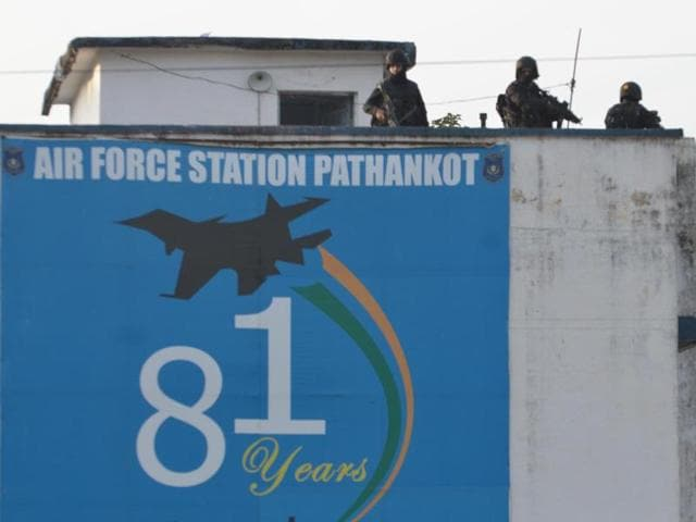 Commando stand guard at Indian Air Force base during search operation after completion of terrorist combing operation in Pathankot.