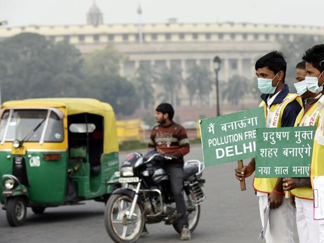 Civil Defence volunteers hold placards at Seelampur as the Even-numbered cars rolled out on Delhi streets and the odd-numbered ones stayed largely off the roads on the sixth day today of the odd-even vehicular restriction trial, in Delhi , India on Wednesday, January 06, 2016.