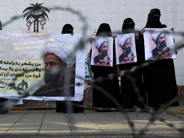 Yemeni women, supporters of Iran-backed Shiite Huthi rebels, hold banners bearing portraits of prominent Shiite cleric Nimr al-Nimr during a demonstration. Huthi rebels in Yemen have intensified cross-border rocket attacks since late last year.