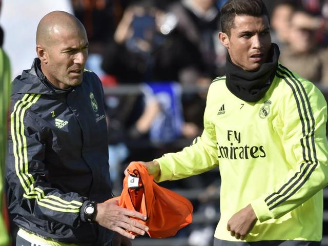 Real Madrid's new  coach Zinedine Zidane and forward Cristiano Ronaldo gesture during his first training session.